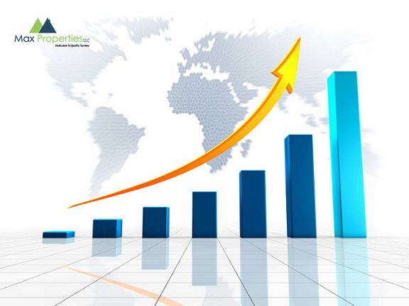 Growing chart with golden arrow pointing upwards, against the world
